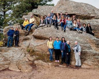 staff on rocks