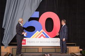 RTD GM and CEO Dave Genova and RTD Board Chair Doug Tisdale unveil 50th logo