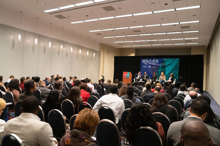 Savvy business owners and entrepreneurs listen attentively to a discussion during a Build It In DC panel