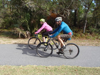 Georgia Ackerman and Rick Zelsnak ride a paved trail, by Doug Alderson