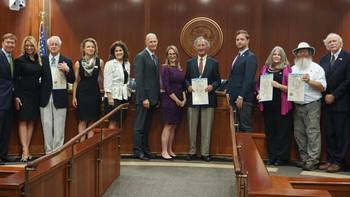 Adam Putnam presents trail commemoration to founder Jim Kern and others at Cabinet meeting