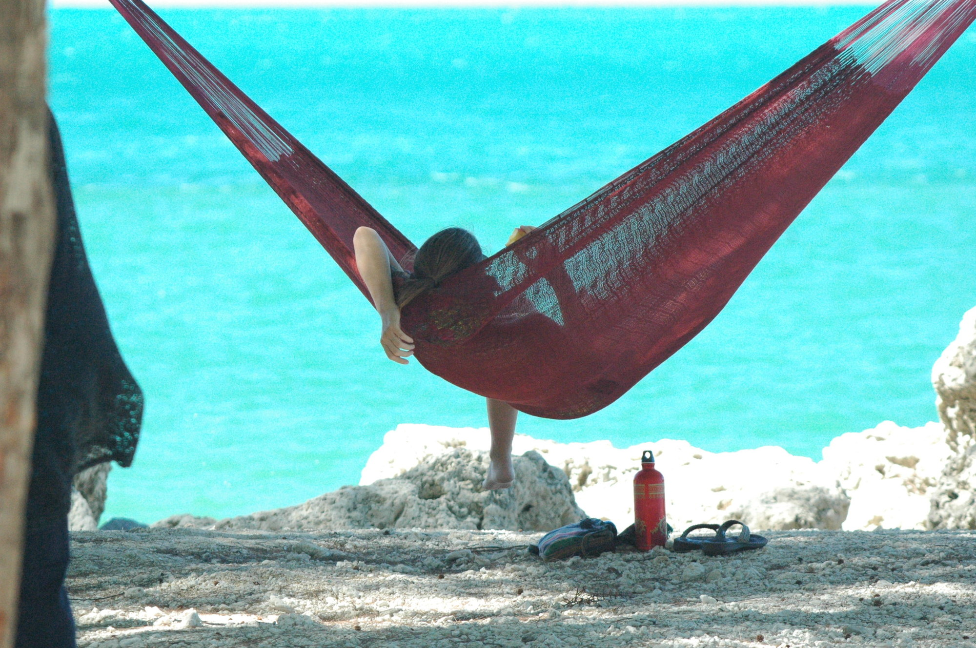 Girl Relaxes in Hammock at Fort ZacharyTaylor Historic State Park