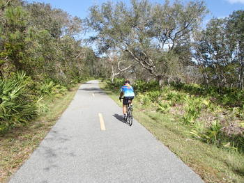 Cyclist on Amelia Island Trail by Doug Alderson
