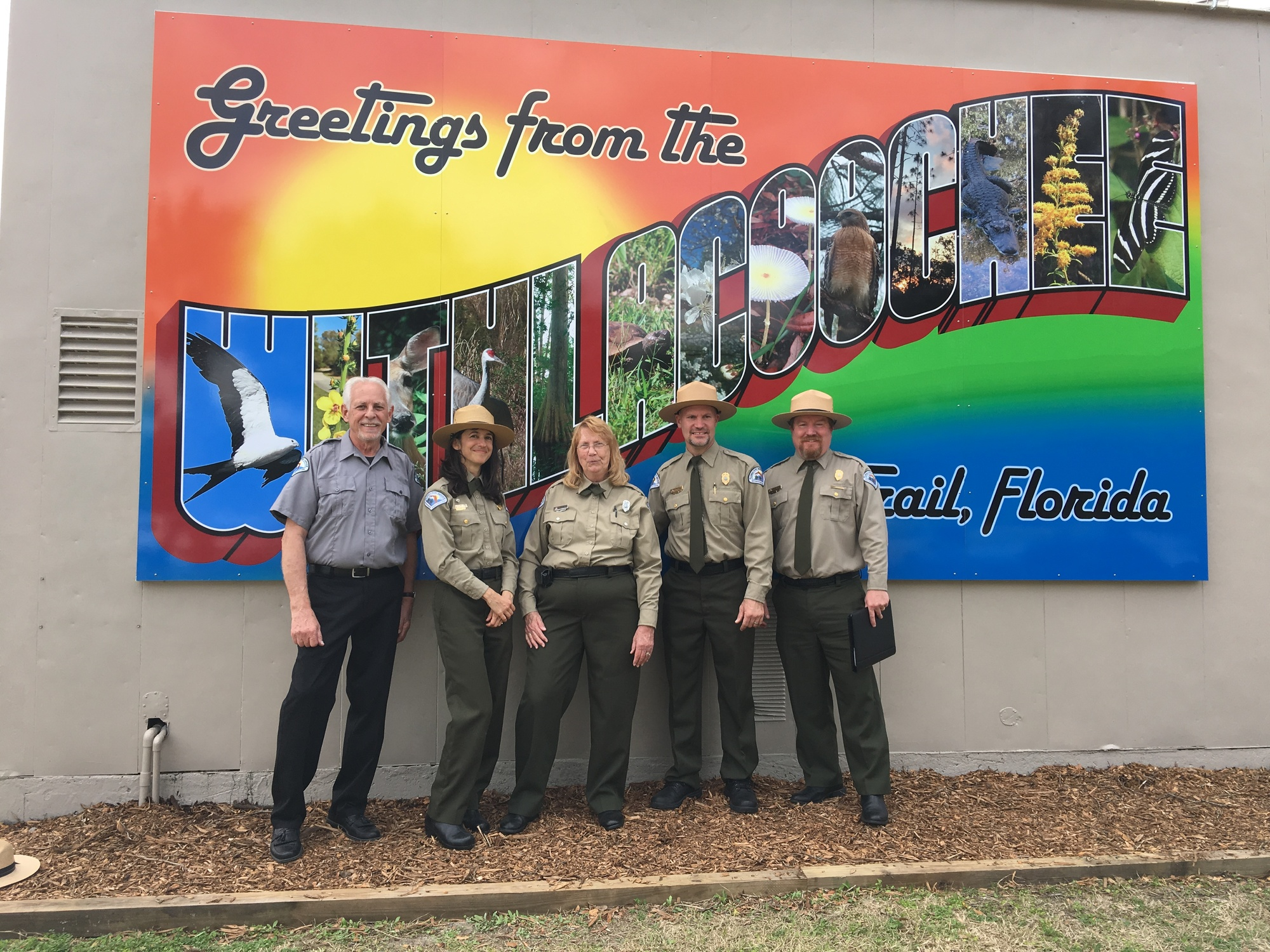 A photo of rangers in front of the new mural at Withlacoochee Trail