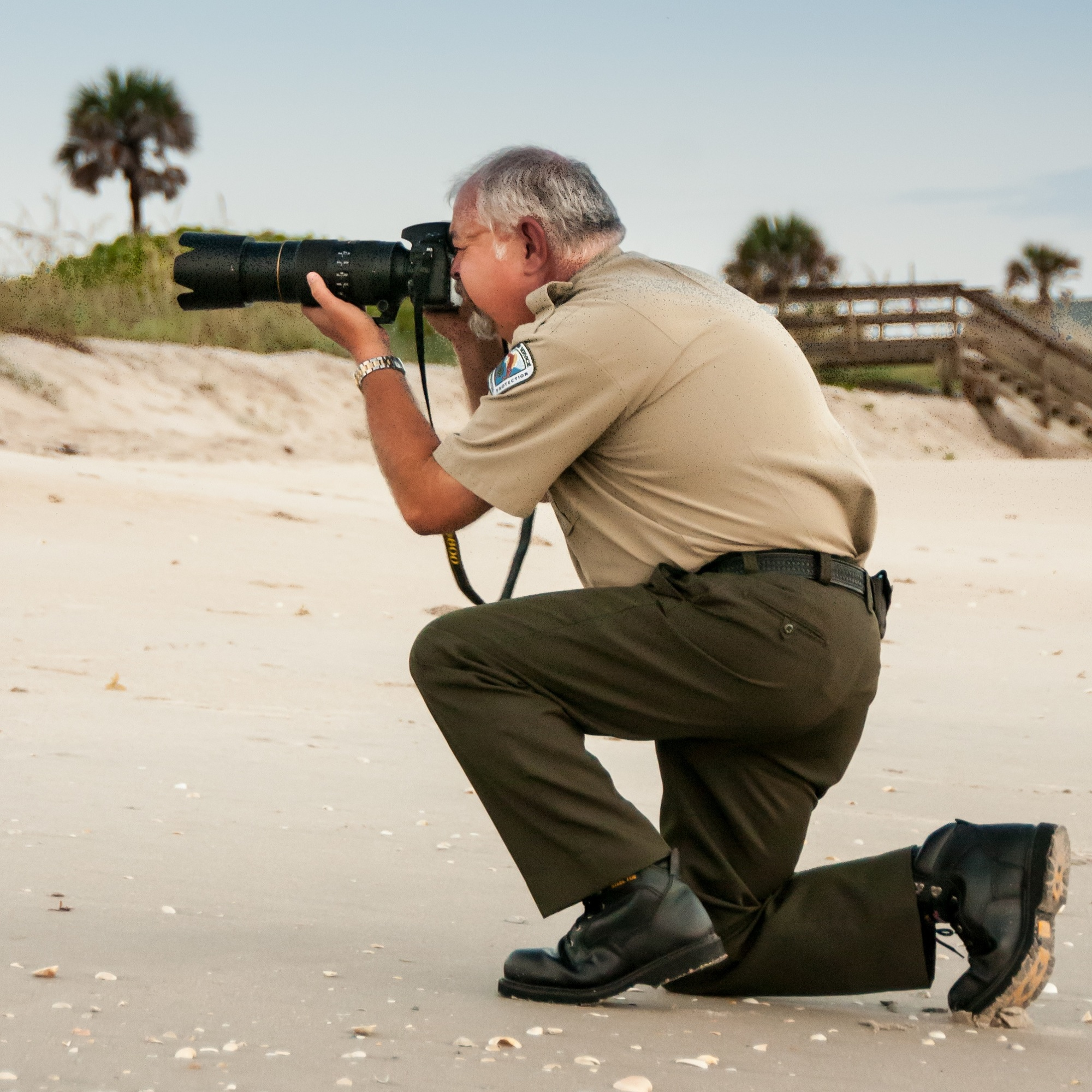 Ed Perry taking a photo on Sebastian Inlet Beach