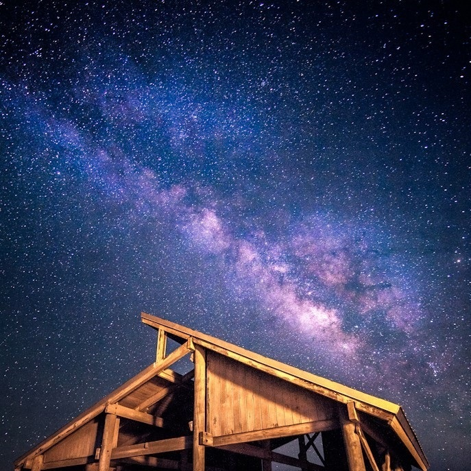 A view of the Milky Way over one of St. George Island's pavilions