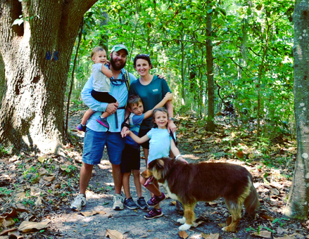 Family of four enjoying a hike in a Florida State Park