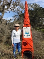 Camille Richards at Ft. Clinch Circumnavigational Trail Marker, by Carl Anderson