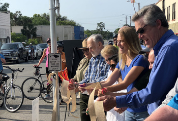 Cutting the ribbon for the Hastings segment of the trail by Donald Morgan