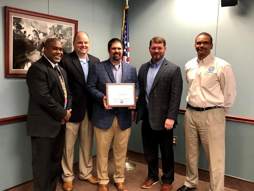City of Pensacola representatives accept ENVIRONMENTAL STEWARDSHIP AWARD