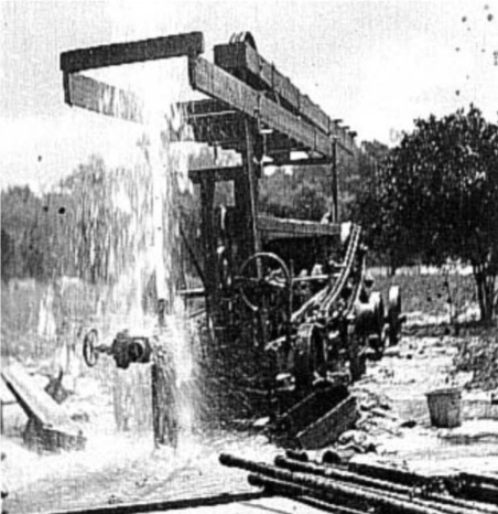 Photo of a flowing artesian well - Palatka, Florida taken by E. H. Sellards