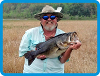 Paul Desrosier with Hall of Fame bass
