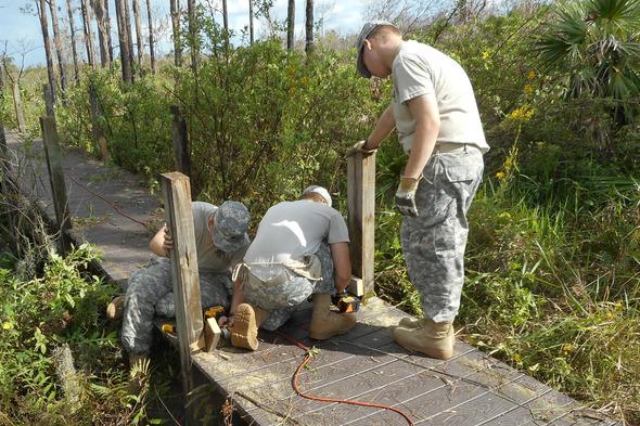 JROTC  Cadets help dismantle a pedestrian bridge