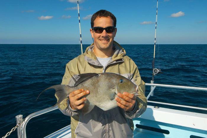 Angler holding triggerfish