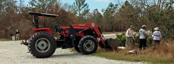 Using a tractor to help load debris