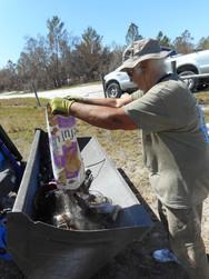 Ridge Rangers unloads gathered bottles into a tractor bucket