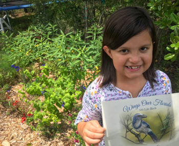 Leila poses with her Wings Over Florida Certificate.