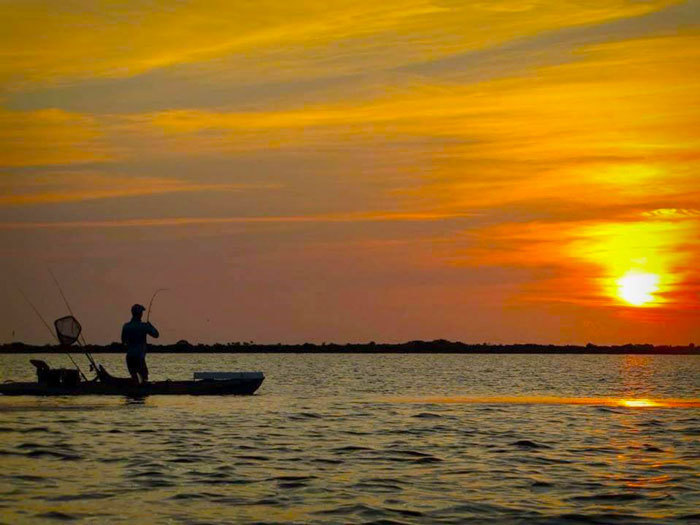 sunset kayak fishing