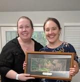 Action Plan Coordinator Allie McCue presents FWLI Biologist Anna Deyle with the 2019 Christine Small Award