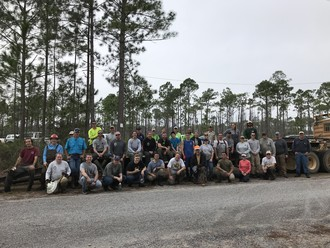 Volunteers and staff from the FWC, Eglin Air Force Base, Jackson Guard and AmeriCorps take a break for a quick photo. Photo by FWC staff.
