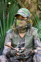 Turkey hunter using a call