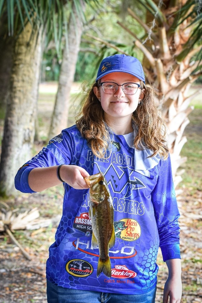 fishing team student holding a fish
