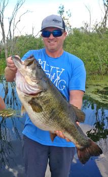 Orange Lake angler with bass