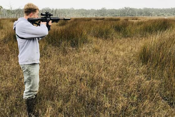 Codey Elrod takes aim at an Ossabaw Island hog (Dan Chapman/USFWS)