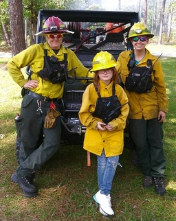 "Fire crew and young ""helper"""