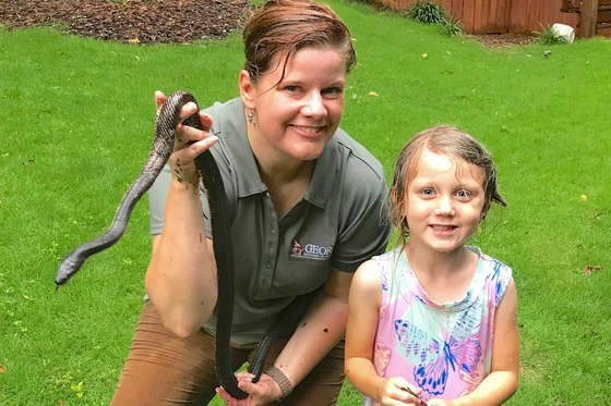 Linda May with freed rat snake (Jennifer Person)
