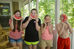Cottage porch kids eating watermelon