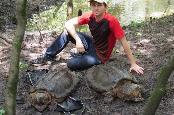 Tyler Brock with two large alligator snappers (Dirk J. Stevenson)