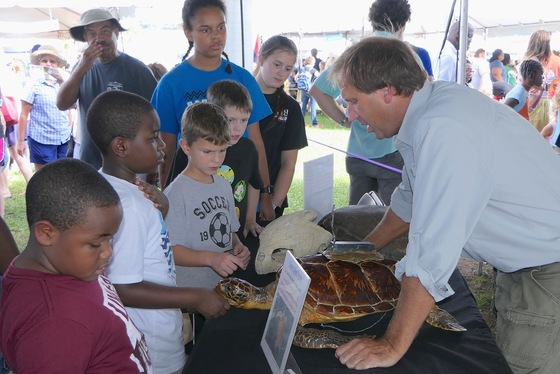 Jason Lee talks sea turtles at CoastFest. (Linda May/DNR)