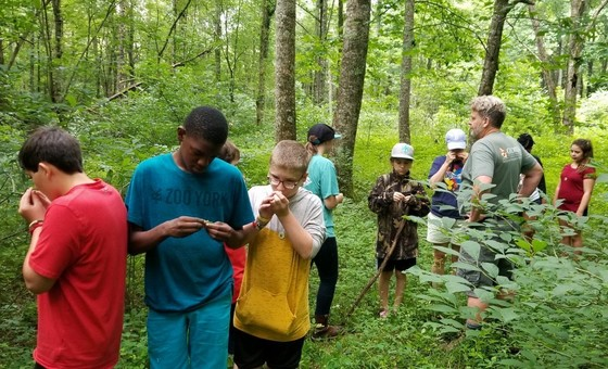 DNR's Dr. Mincy Moffett Jr. leads the Sci-Fries through north Georgia forest (Deanna Ryan/Swainsboro Middle School)