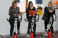 Teachers riding stationary bikes