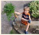 Boy Holding Carrot