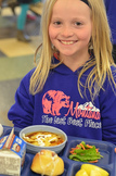 girl with school lunch tray