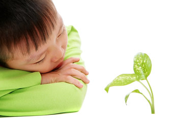 Grow opportunity picture of child with growing plant