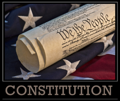 photo showing rolled up U.S. Constitution, U.S. flag background