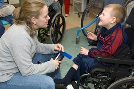 Teacher with wheelchair bound student