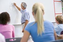 Math teacher at white board drawing a diagram