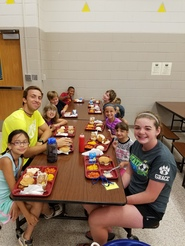 Nevada Community School District Central Elementary students sitting at cafeteria tables eating lunch