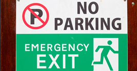 A no parking, emergency exit sign