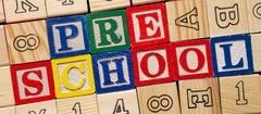 Wooden blocks that spell preschool