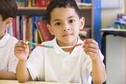 Boy with math manipulatives