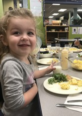 Preschool child eating lunch