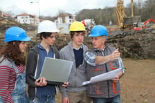 Students learning at construction site