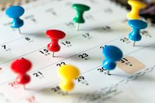 Push pins on calendar.
