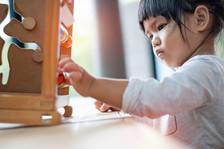 Asian preschooler working with blocks.
