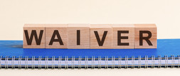Letter tiles spelling WAIVER